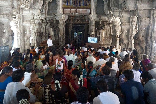 Devotees chant mantras at the Virupaksha temple.