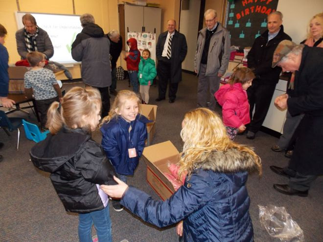 A little girl at George G Blaisdell Elementary School flashes a big smile after trying on a new winter coat delivered to the campus by members of the Bradford Rotary Club. Photo: Kate Day Sager/The Bradford Era