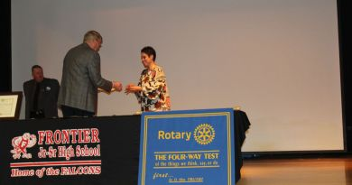 Frontier Rotary Club Secretary Dawn Girard receives her Rotary International pin from DG-elect Dan Ryan marking her as a Rotary member at the charter ceremony for the new club. Photo: James D Wolf Jr