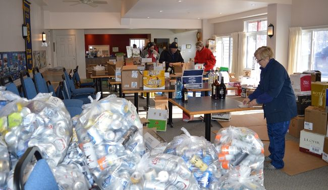Stirling Rotarian Donna Graff (foreground) sorts and counts the many bottles and cans donated by local residents to the local service club's first annual bottle drive held in the first week of the new year. Photo: Terry Vollum/The Intelligencer