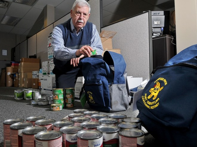 Ron Goyette, the past president of Port Coquitlam Centennial Rotary, helps pack food for the club's knapsack lunch programme that helps get food to kids who need it at a local school once a week. Photo: Mario Bartel/ Tri-City News
