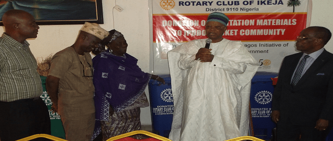 PDG Prince Julius Adelusi Adeluyi speaking at the event to distribute sanitation materials to the Ipodo Community Market in the presence of government officials.