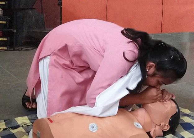 A student gets trained in administering mouth-to-mouth resuscitation.