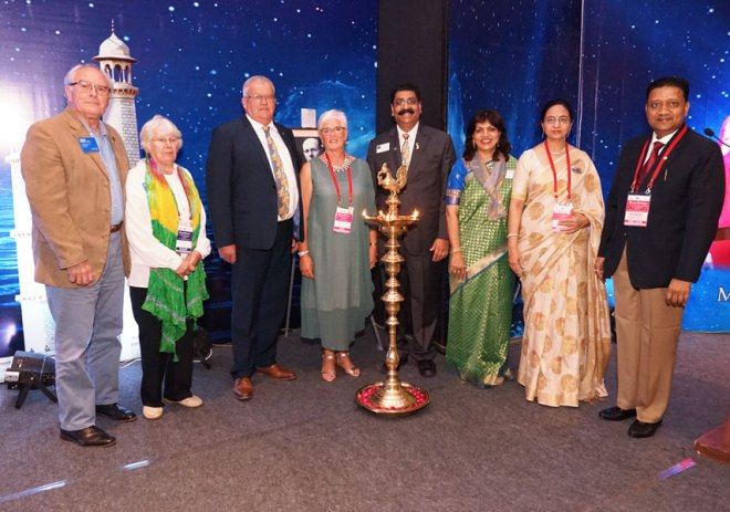 From L: RID Brian Stoyel, spouse Maxine, RIPR Stuart Heal, spouse Adrienne, DG Maullin Patel, spouse Sonal, RC Jaipur South President Vandana Prakkash and Conference Chairman Rajendra Prakkash.