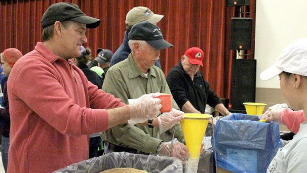 Members of the Portsmouth Rotary Club, Richard Wentz, Duff Porter and Ed Eaves, volunteered with Rise Against Hunger at Ebenezer United Methodist Church in Virginia on Saturday.
