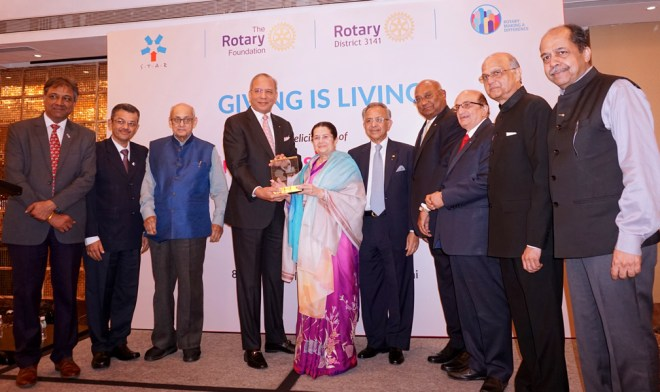 PRIP K R Ravindran presents the Rotary Crystal to Rajashree Birla, Chairperson of the Aditya Birla Foundation for Community Initiatives and Rural Development, in the presence of (from L) DG Prafull Sharma, RIDN Bharat Pandya, PRIP Kalyan Banerjee, PRIP Rajendra K Saboo, RID C Basker, PRID Ashok Mahajan, TRF Trustee Elect Gulam Vahanvaty and RRFC Vijay Jalan.