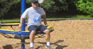 Quinto D'oraizo enjoys some of the equipment at the new Norma Bangay Park in Palgrave. Photo: Matthew Strader/Metroland