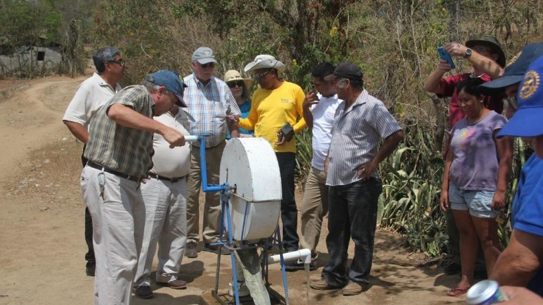 Rotary Club of Tulsa members inspect the look at the new water pump in a Nicaraguan village. Photo: Rotary Club of Tulsa