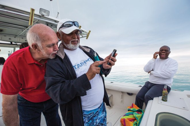 Rassin enjoys some time on the water with his good friends Wade Christie (centre) and Felix Stubbs.