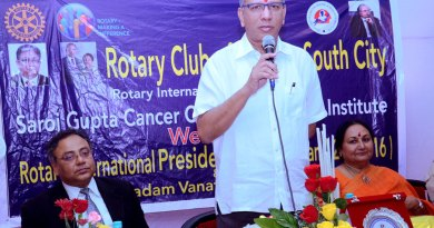 PRIP K R Ravindran speaks at the Silver Jubilee celebration of RC Calcutta South City. Vanathy Ravindran and Hospital Secretary Anjana Gupta are also present.