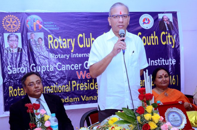 PRIP K R Ravindran speaks at the Silver Jubilee celebration of RC Calcutta South City. Vanathy Ravindran and Hospital Secretary Anjana Gupta are also present.