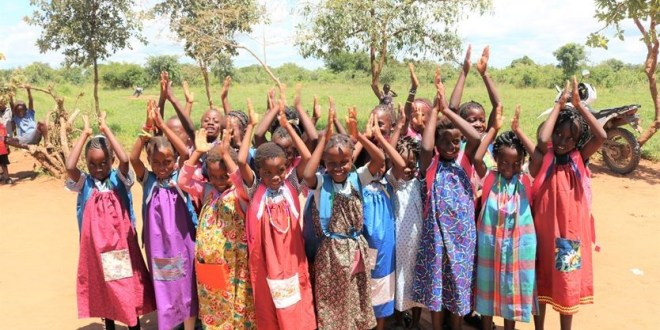 Students gather in their new lightweight dresses, which were provided as part of the Rotarians Enhancing Learning of African Youth project in Zambia. Photo: Shelly Duben