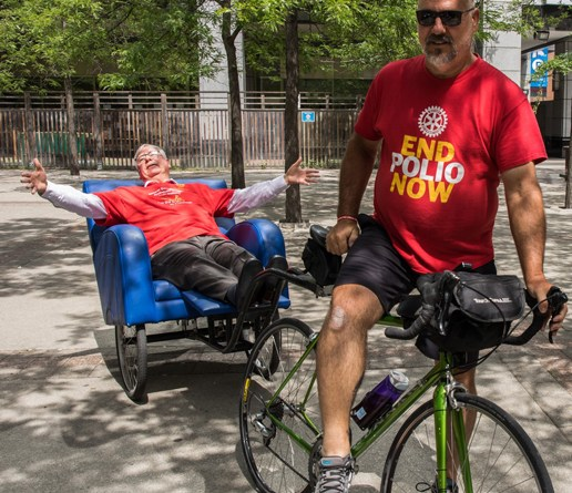 Rtn Ralph Zuke, President of RC Fairview Heights, Illinois, rode a rickshaw 800 miles (about 1,285 km) from St Louis, Missouri, to the Rotary International Convention in Toronto. The 22-day ride raised $22,000 for TRF's Polio Fund. He was received by RI President Ian Riseley at the Simcoe Park opposite the Convention venue on June 22. Picture: Rotary International