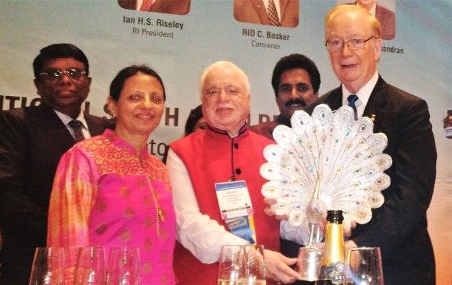 TRF Trustee Chair Paul Netzel being honoured by Trustee Sushil Gupta and Vinita. Event Chair R Theenachandran and Secretary John Daniel are also in the picture.