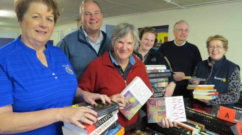New Rotary District Governor Susan Wakefield (Left) on the job with fellow Rotarians preparing book displays for Lower Blue Mountains Rotary's successful Book Fair at the monthly markets in Glenbrook.