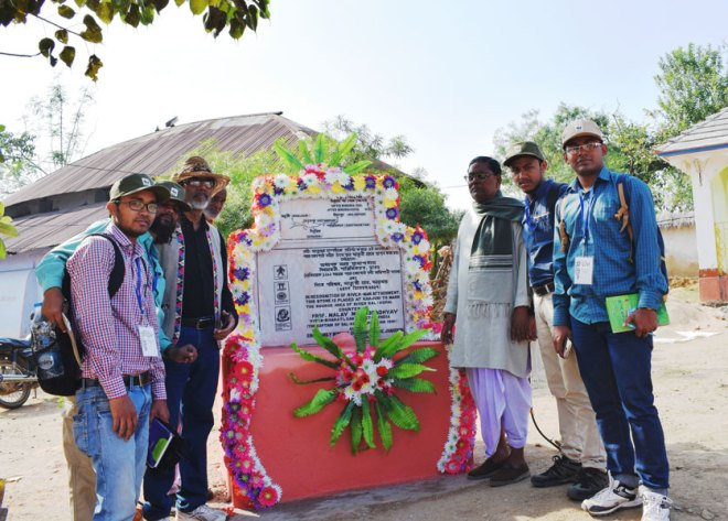 The team revisits the marker stone installed by Prof Mukhopadhyay 25 years ago.