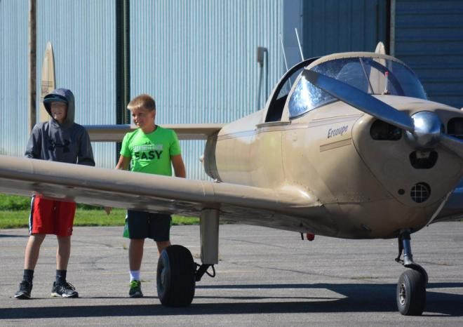 A couple of young visitors at a past Rotary Fly-in Breakfast check out an aircraft at Fremont Municipal Airport. Photo: Fremont Tribune
