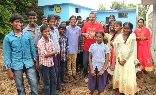 PDG Ravi Vadlamani with students in one of the schools.