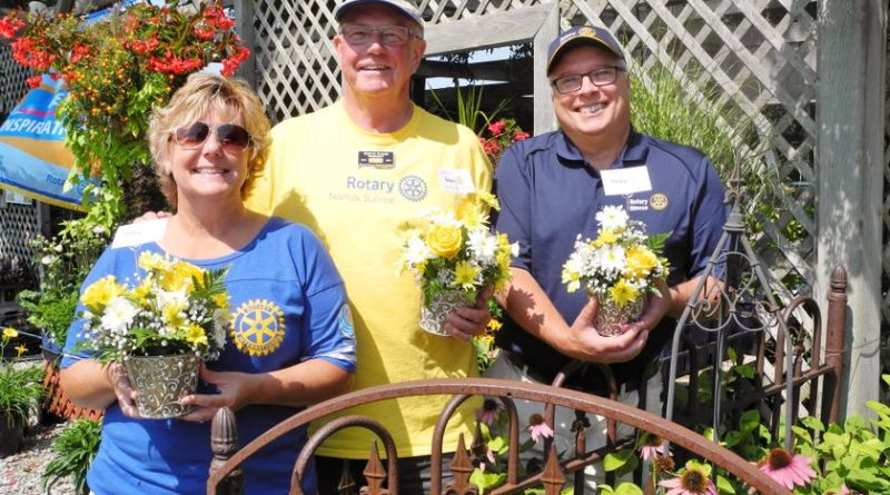 """Local Rotarians' first """"Day of Action"""" in Norfolk coincided with a visit from RI District 7090 Governor Melisa Schrock, left, of Akron, New York. she was welcomed by Keith Jones, centre, President of the Rotary Club of Norfolk Sunrise, and Dave King, President of the Simcoe Rotary Club.  Photo: Monte Sonnenberg / Simcoe Reformer"""
