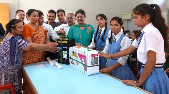 RC Moradabad Central donates a sanitary napkin vending machine to a school in their city. Seen in the picture are PDG Akhilesh Kothiwal (centre), and club president Anujj Agarwal (to his left).