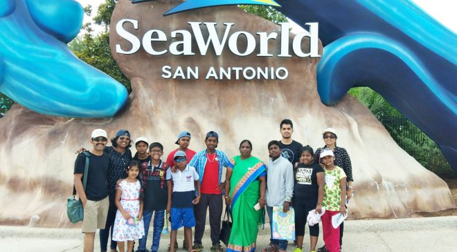 The schoolchildren all set to tour the Sea World. Also seen: Rotarians Magesh Pattabhiraman (left) and N Nagalakshmi (right) of RC Madras East.