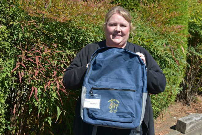 North Delta Rotary President Kim Kendall holding a Starfish Backpack. Photo: Grace Kennedy