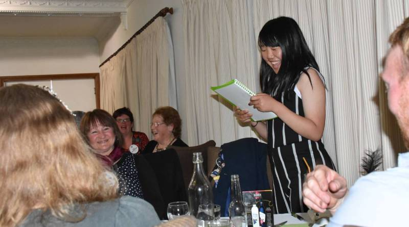 Rotary youth exchange student Tsumiki Katsuragawa reports on her school holiday adventures to an impressed assembly of Rotarians.