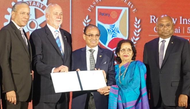 RI President Barry Rassin honours PDG J K Gaur and his wife Usha as AKS members in the presence of PRIP K R Ravindran and RID C Basker.