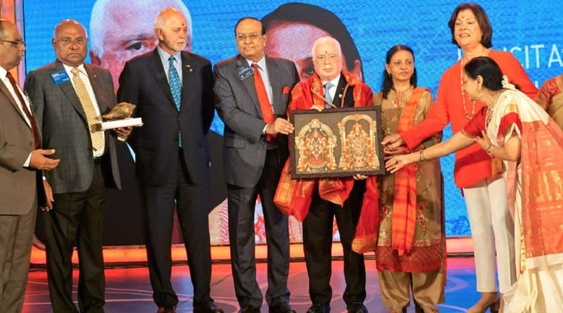 PRID P T Prabhakar and Nalini present RIPN Sushil Gupta and Vinita a portrait of Lord Balaji from Tirupati, in the presence of (from L) Institute Chairman ISAK Nazar, RID C Basker, RI President Barry Rassin, Esther Rassin and Mala Basker.