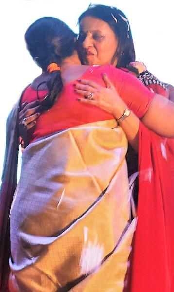 Mala Basker greets Vinita with a warm hug.