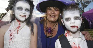 Ready for Halloween: Nine-year-old Zoey Jew, Alfredton Rotary event coordinator Kathy Rivett and Riley Jew, 6. Photo: Lachlan Bence