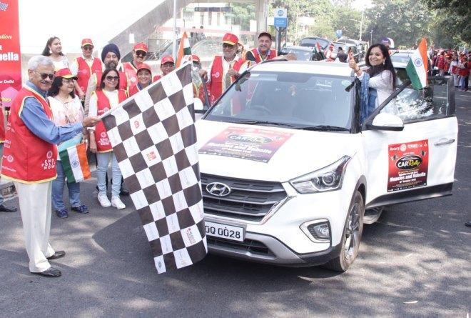 INPPC Chair Deepak Kapur flagging off a car rally in Delhi.