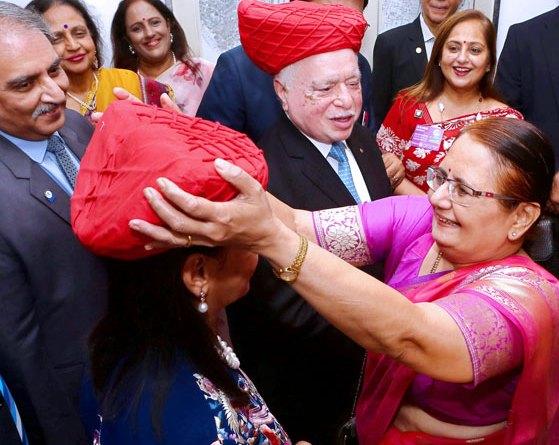 Madhavi greets Vinita with a pagdi as RIPN Sushil Gupta looks on.