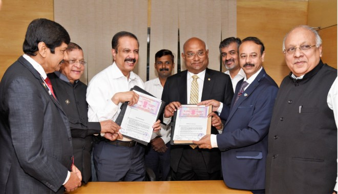 Aster Group Chairman Dr Azad Moopen and RID C Basker after signing the MoU.