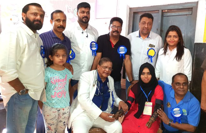 DG Dr E K Ummer (centre) with a beneficiary and Rotarians of RC Nilambur. K V Mohankumar (right), LN 4 Ambassador for South Asia, is also seen.