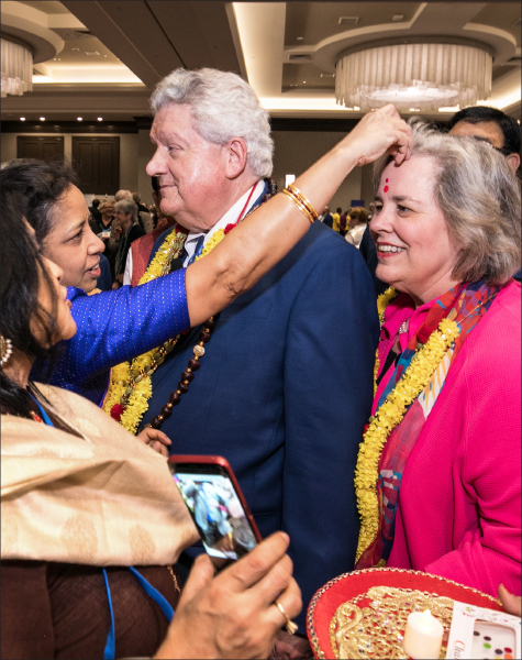 RIPE Mark Maloney and Gay being greeted by Indian delegates.