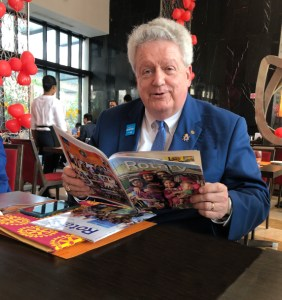 After addressing the PETS and SETS conference of RI District 3250 in Kolkata, RI President Elect Mark Maloney took some time off to glance through two issues of Rotary News.