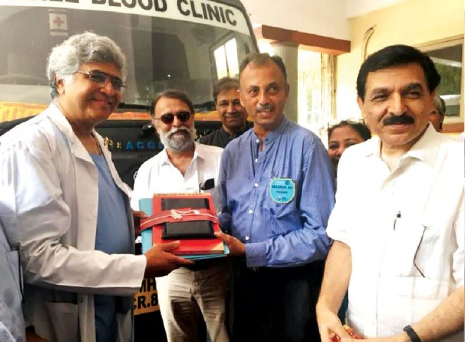Masroor Ali hands over a blood collection van to an official of the Tata Memorial Hospital PDG Prafull Sharma is also in the picture.