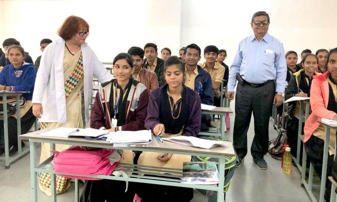 Prafull Dewani, Trustee, Rotary Charitable Trust, and Sandra Shroff Nursing College Principal Maj Gen T K Bhutia with the college students.