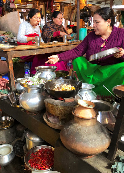 Fresh food prepared and served at an all-women's market in Imphal.