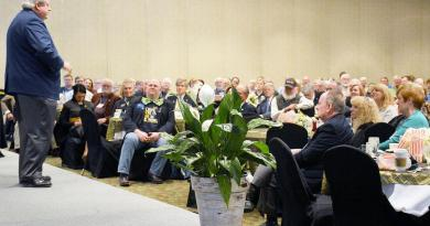 Members of the Land of Lincoln Rotary listen to a presentation from RIPE Mark Maloney at the Thelma Keller Convention Center. Photo: Kaitlin Cordes