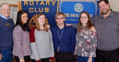 From Left: Penn Yan Rotary President Bob Smith with teacher Brittany Wright, Emma, Grant, Becky and David Andersen. Photo: Chronicle-Express