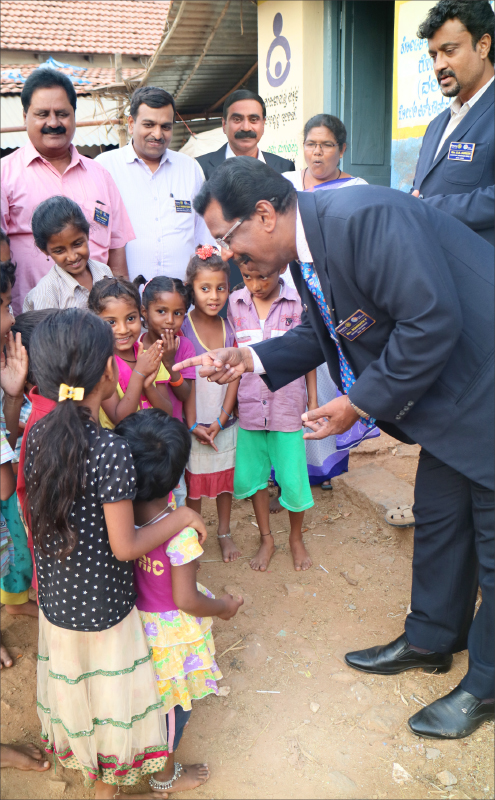 DG P Rohinath interacting with children at an anganwadi. Project Chairman H M Harish (third from left) is also in the picture.