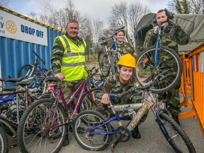 From Left: Stephen Pethe, Megan Ryan, Caoimhe Molloy and Alan Kiely helping load the bicycles onto the army truck for their first part of the bikes' journey to Africa. Photo: Pat Moore