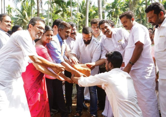 Actor Jayasurya laying the ­foundation stone for the cluster homes. Member of RC Calicut Midtown Dr Rajesh Subhash (third from left), and Project Chair Dileep Narayanan (fourth from left) are also in the picture.