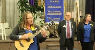 Australian Group Study Exchange participant Stacey Andary performs an Aussie folk song at a Rotary club meeting. Photo: Jessica Karins/Daily Express