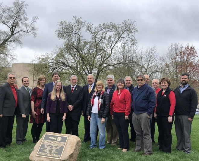 College faculty and Rotarians at the tree planting ceremony.