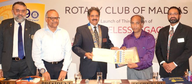 RC Madras President Ranjit Pratap releasing a special postal stamp to mark the golden jubilee year of the club in the presence of (from L) N K Gopinath, V Sriram, an India Post official and Nikhil Raj at the book launch.