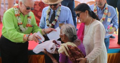 John Gale from RC Cataraqui Kingston presenting gifts to an elderly woman at Kannankottai village. Also seen are RC Madras President Ranjit Pratap, President-elect Dr Vijaya Bharathi and Rick Fiedorec (right), President of the Canadian club.