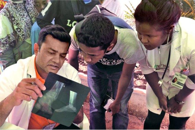 Orthopaedic surgeon Dr Romesh Gaur examines an X-ray.